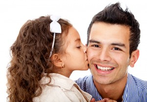 Girl kissing her father.   BigStockPhoto.com / andres