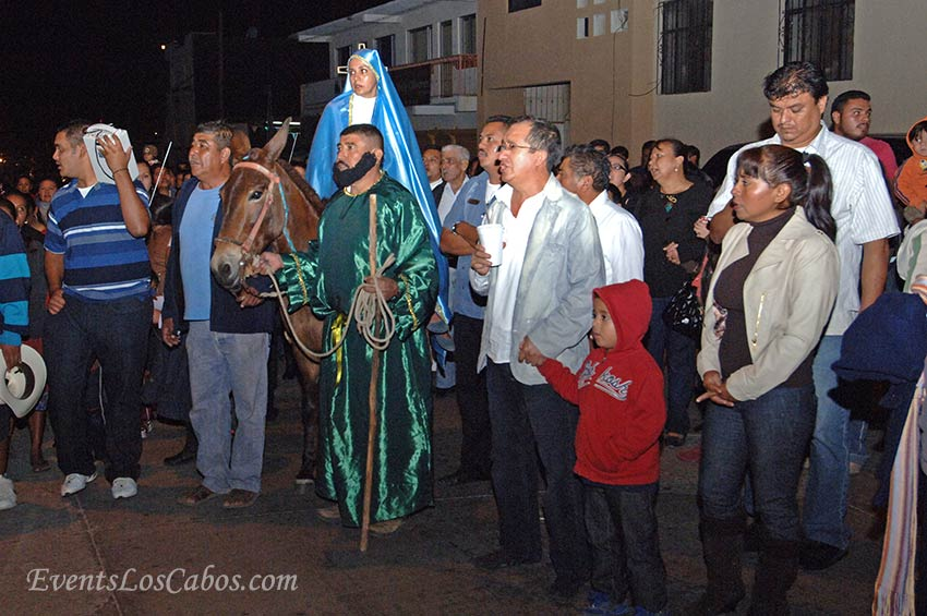 A Christmas Posada procession taking place near the Santuario de Guadalupe Catholic Church.