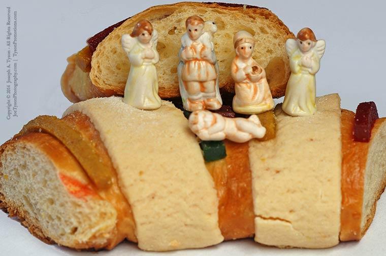 Plastic figurines or dolls hidden inside a Rosca de Reyes pastry. Photo © Joseph A. Tyson