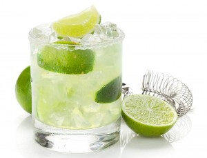 Classic margarita cocktail with lime in old fashion glass.